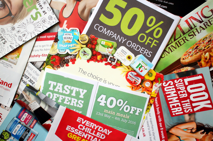 London, United Kingdom - JULY 25 2016: Sample of junk mail items delivered to a private residence in England as advertising for local retail businesses and services